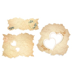 Vintage paper pieces with heart vector