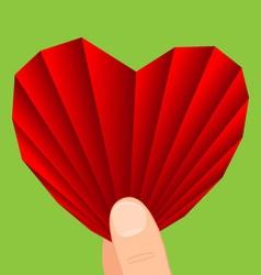Heart in hand vector image vector image