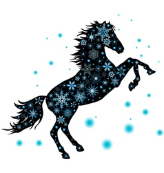 A silhouette of a horse with snowflakes vector