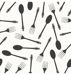 Spoons and forks seamless pattern vector