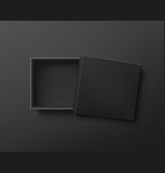 Opened black empty gift box on dark background vector
