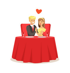 young elegant couple sitting at table in a cafe vector image