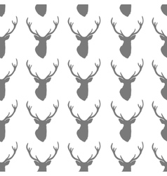 Seamless pattern with silhouette of deer head on vector