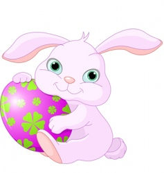 Easter rabbit holds egg vector