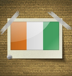 Flags Cote dlvoire at frame on a brick background vector image