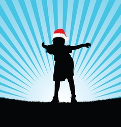 Child with christmas hat silhouette vector