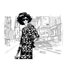 Fashion girl on a street background vector