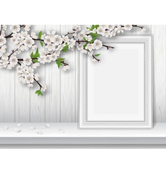 Spring blooming cherry branch and photo frame on a vector image vector image