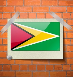 Flags guyana scotch taped to a red brick wall vector