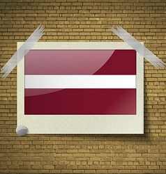 Flags latvia at frame on a brick background vector