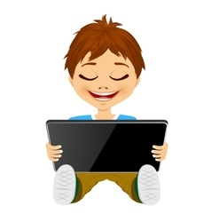 Little boy having fun playing using digital tablet vector