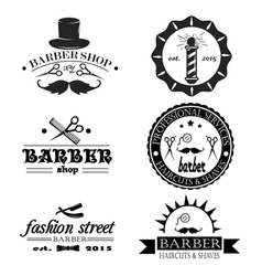 Set of vintage barber shop logo labels badges an vector