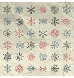 Winter snow flakes doodles on crumpled vector