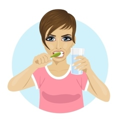 Woman brushing teeth holding glass of water vector