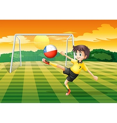 A girl kicking the ball with the Chile flag vector image