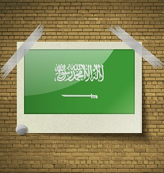 Flags saudi arabiaat frame on a brick background vector