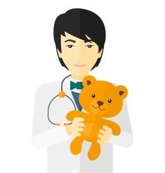 Pediatrician holding teddy bear vector