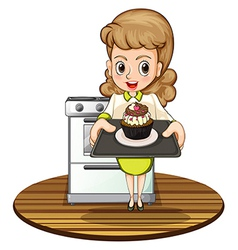 A lady baking a cupcake vector image