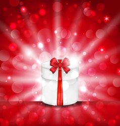 Round gift box on light red background with glow - vector