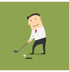 Businessman putting ball into a hole vector image