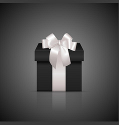 Black square gift box with white ribbon and bow vector