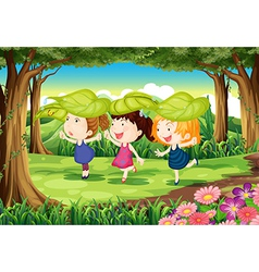 Three playful kids at the forest vector