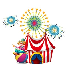A clown sitting above the ball at the carnival vector image
