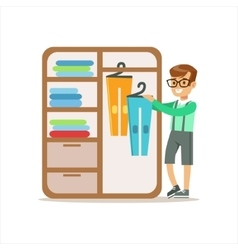 Boy ranging clothes in dresser smiling cartoon kid vector