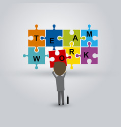teamwork concept of businessman and jigsaw puzzle vector image
