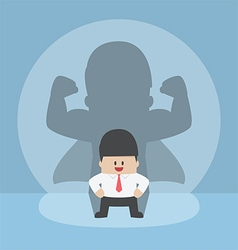 Businessman with his strong shadow vector