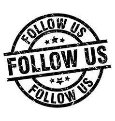 Follow us round grunge black stamp vector