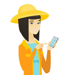 Young asian farmer holding a mobile phone vector