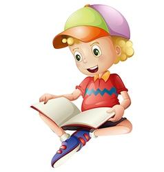 A cute kid reading vector image vector image