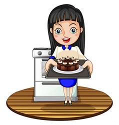 A girl baking a cake vector image