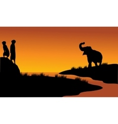 Meerkat and elephant in riverbank vector