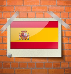 Flags spain scotch taped to a red brick wall vector