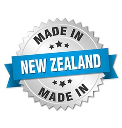 Made in new zealand silver badge with blue ribbon vector