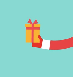 Santa claus holds present flat design vector