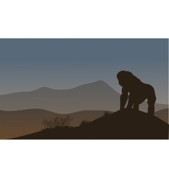 Gorilla silhouette in the hills vector