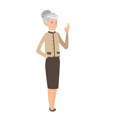Senior caucasian business woman showing ok sign vector