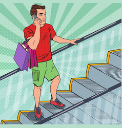 Pop art young man with shopping bags on escalator vector