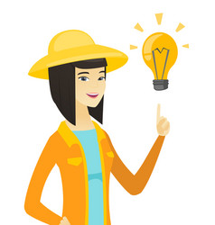 Young asian farmer pointing at idea light bulb vector