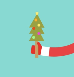 Santa claus holds christmas tree flat design vector