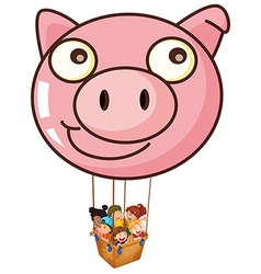 A pig balloon carrying a basket with kids vector image vector image