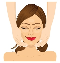 attractive young woman enjoying facial massage vector image vector image