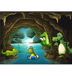 Crocodiles swimming in the cave vector image