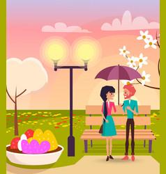Couple under umbrella in park near streetlight vector
