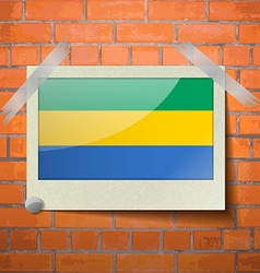 Flags gabon scotch taped to a red brick wall vector