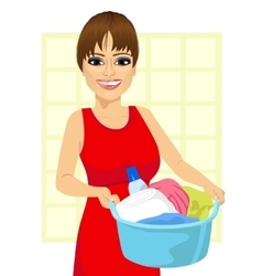 Woman holding a laundry basket vector