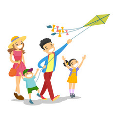 young caucasian white family playing with a kite vector image